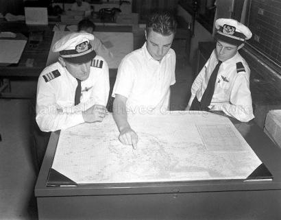 airline crew planning flight routes at kallang airport 1950a